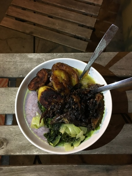 Blue cornmeal Caribbean Pap porridge with plantain and coconut greens