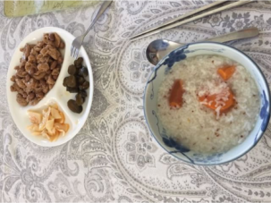 Beautiful guest breakfast submission, appears to be coconut flakes, persimmon, wheat porridge